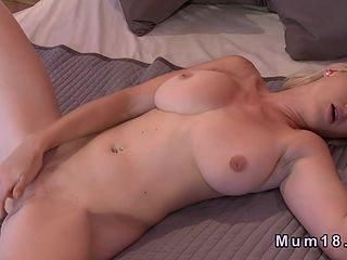 Mature masturbating on bed